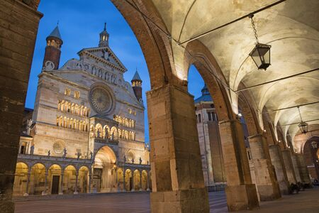 portico: Cremona - The cathedral  Assumption of the Blessed Virgin Mary  and the portico of the Town hall at dusk. Stock Photo