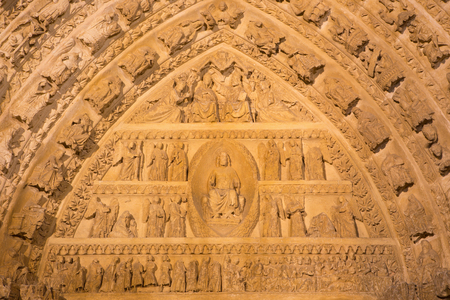 coronation: AVILA, SPAIN, APRIL - 18, 2016: The detail of north portal of Catedral de Cristo Salvador (1470) with the Last Judgment and Coronation of Virgin Mary scenes. Editorial