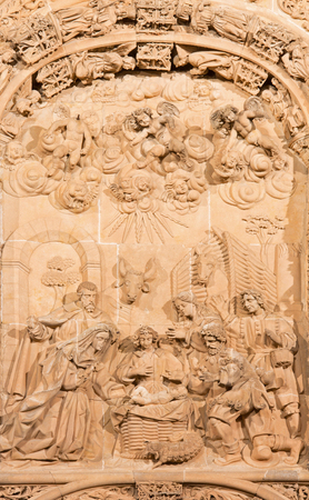 16 17: SALAMANCA, SPAIN, APRIL - 17, 2016: The Nativity relief on the gothic-baroque west portal of the New Cathedral - Catedral Nueva from 16. cent.