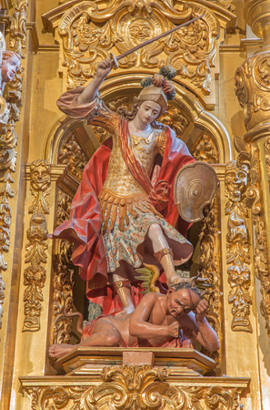 polychrome: SEGOVIA, SPAIN, APRIL - 14, 2016: The carved polychrome baroque statue of archangel Michael in church Monasterio de San Antonio el Real by unknown artist of 17. cent.