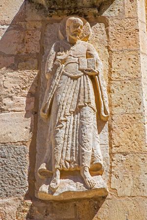 SEGOVIA, SPAIN, APRIL - 14, 2016: The relief of apostle on the facade of romanic church Iglesia de San Miguel. Editorial