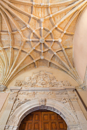 convento: SALAMANCA, SPAIN, APRIL - 16, 2016: The gothic archs of atrium and baroque portal of monastery Convento de San Esteban.