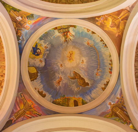 convento: AVILA, SPAIN, APRIL - 19, 2016: The fresco of St. Francis and franciscan holys in cupola from 20. cent. in church Convento San Antonio by unknown artist. Editorial