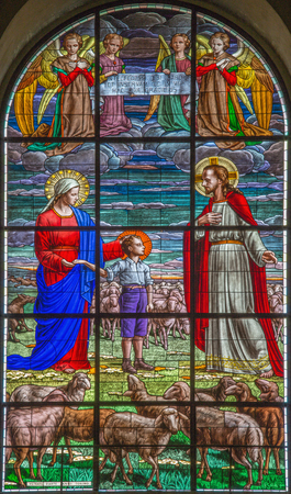 age 10: ROME, ITALY - MARCH 10, 2016: The scene of The dream od Don Bosco at the age of nine (1825) in the stained glass of church Basilica di Santa Maria Ausiliatrice by Janni Torino (20. cent.)