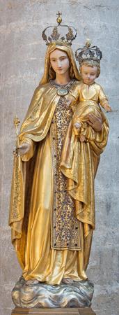 polychrome: BRESCIA, ITALY - MAY 23, 2016: The carved polychrome statue of Madonna in church Chiesa di Santa Maria del Carmine by unknown artist.