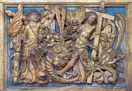 polychrome: BRESCIA, ITALY - MAY 23, 2016: The polychrome baroque relief of angels withe the cross in church Chiesa di San Giovanni Evangelista by Brescian school from 16. cent. Editorial