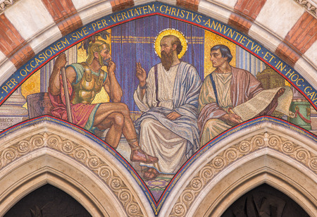 ROME, ITALY - MARCH 24, 2015: The mosaic Teaching of St. Paul in carcer by George Breck (1909) on the main portal of church Chiesa di San Paolo dentro le Mura. Editorial