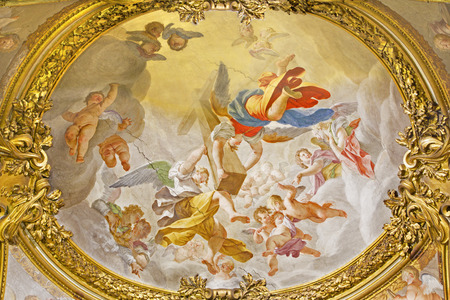 ROME, ITALY - MARCH 9, 2016: The fresco Angels with the cross in church Chiesa di San Silvestro in Capite by Francesco Trevisiani  (1656 - 1746).