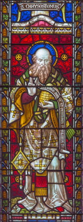 ROME, ITALY - MARCH 9. 2016: The St. John the Chrisostom on the stained glass of All Saints Anglican Church by workroom Clayton and Hall (19. cent.)
