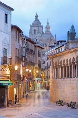 bravo: SEGOVIA, SPAIN, APRIL - 14, 2016: Calle Juan Bravo street and the Cathedral in the background at dusk.