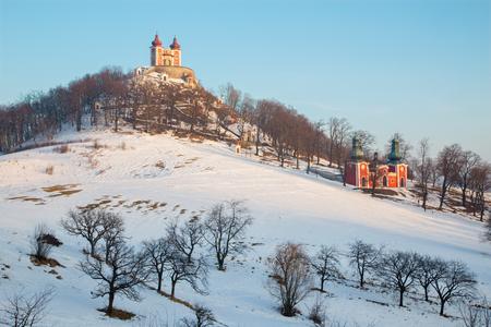 calvary: Banska Stiavnica - The baroque calvary built in years 1744 - 1751 in winter evening Stock Photo
