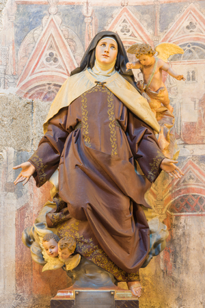 polychrome: AVILA, SPAIN, APRIL - 18, 2016: The polychrome carved statue of St. Theresia of Avila in Catedral de Cristo Salvador by unknown artist from year 1964. Editorial