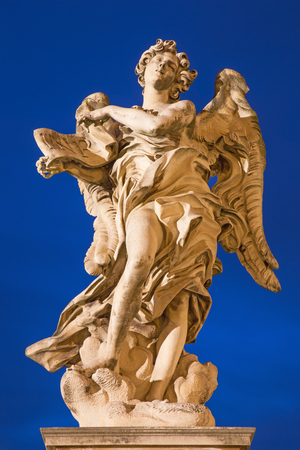 bernini: ROME, ITALY - MARCH 9, 2016: Rome - Angel with the superscription by Gian Lorenzo Bernini (1598 - 1680) and son Paolo (original at SantAndrea delle Fratte, copy by Giulio Cartari.