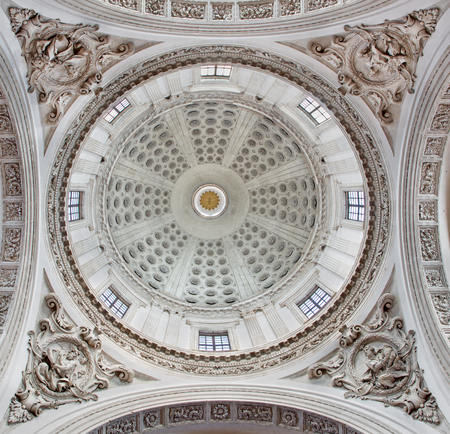 BRESCIA, ITALY - MAY 22, 2016: The baroque cupola of Duomo Nuovo withe the reliefs of The Four Evangelists by Giovan Battista Carboni and Santo Calegari the younger from 18. cent.