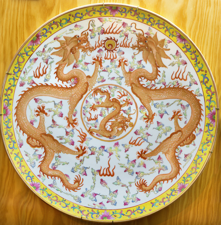 AVILA, SPAIN, APRIL - 18, 2016: The chinese plate with two dragons from the period of Qinig dynasty  in collections of church of Real monasterio de Santo Tomas from years (1736 - 1795)