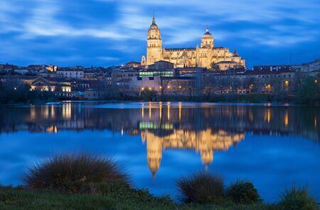 salamanca: Salamanca - The Cathedral and the Rio Tormes river at dusk.