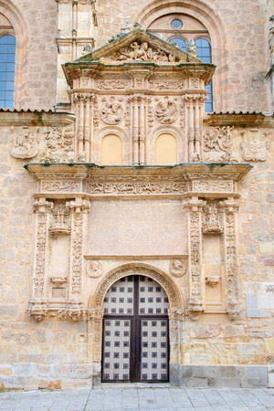 plateresque: SALAMANCA, SPAIN, APRIL - 17, 2016: The plateresque - gothic portal of church Iglesia de Sancti Spiritus from 16. cent. with the medailons of st. Peter and Paul and storys of Petrarca in the reliefs.