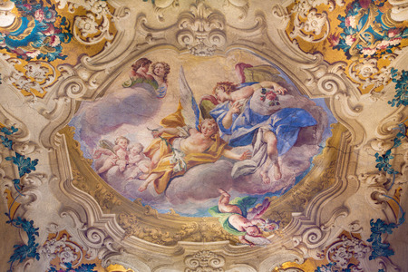 BRESCIA, ITALY - MAY 23, 2016: The of angels with the flowers on cupola of side chapel in church Chiesa di San Giovanni Evangelista by  Antonio Calegari from 18. cent.