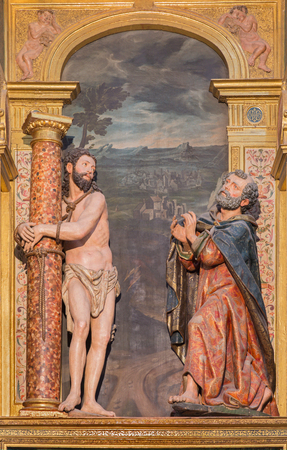 polychrome: SEGOVIA, SPAIN, APRIL - 14, 2016: The carved polychrome sculptural group Flagallated Jesus and st. Peter in Cathedral of Our Lady of Assumption designed by Pedro de Bolduque (1585).