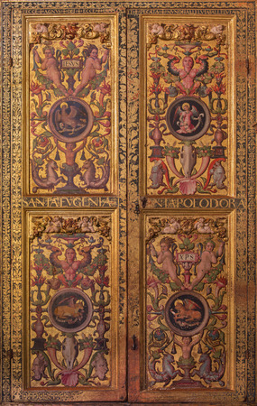 plateresque: AVILA, SPAIN, APRIL - 18, 2016: The plateresque decorative door in the sacristy of Catedral de Cristo Salvador by Cornelius de Holanda from 16. cent. with the symbolic of the Four Evangelists.