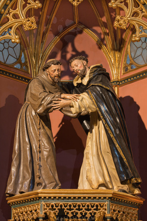 AVILA, SPAIN, APRIL - 19, 2016: The carved polychrome statue of St. Francis and St. Dominic in church of Real monasterio de Santo Tomas by unknown artist.