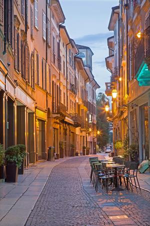 CREMONA, ITALY - MAY 24, 2016: The street Via Solverino in morning dusk.