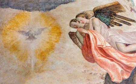 symbolic: BRESCIA, ITALY - MAY 21, 2016: The fresco of angels adorating of Holy Spirit in church Chiesa del Santissimo Corpo di Cristo by Paolo da Caylina il Vecchio (circa 1501).
