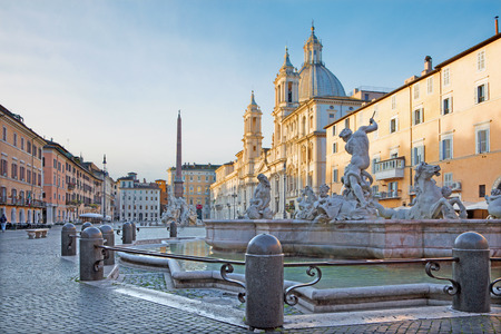 Rome - Piazza Navona in morning and Fountain of Neptune (1574) created by Giacomo della Porta and Santa Agnese in Agone church Editorial