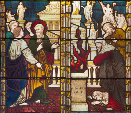 ROME, ITALY - MARCH 9. 2016: The Sermon of St. Paul in Athens on Aeropagus hill on the stained glass of All Saints Anglican Church by workroom Clayton and Hall (19. cent.)