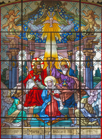 VIENNA, AUSTRIA - DECEMBER 19, 2016: The Coronation of Virgin Mary on the stained glass of church Mariahilfer Kirche by prof. Rudolf Geyling (1897) in workroom Carl Geylings Erben.