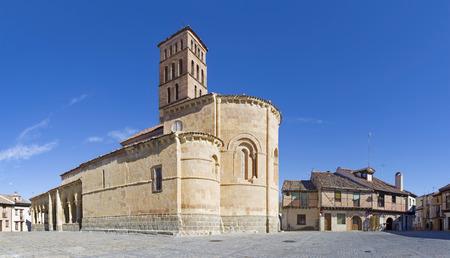 millan: SEGOVIA, SPAIN, APRIL - 15, 2016:  The Romanesque church Iglesia de San Lorenzo and the square with the same name.