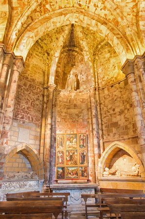 AVILA, SPAIN, APRIL - 18, 2016: The side chapel in Catedral de Cristo Salvador with the altar by unknown artist of 16. cent.