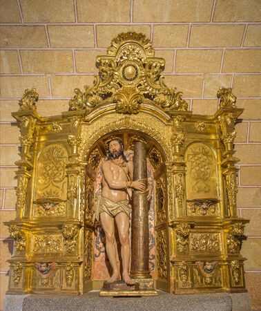 AVILA, SPAIN, APRIL - 19, 2016: The carved polychrome baroque altar with statue of Flagellated Jesus in church Basilica de San Vicente.