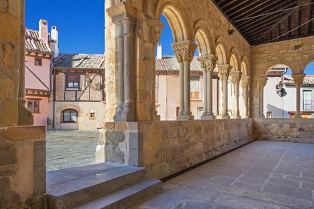 millan: Segovia - The portico of Romanesque church Iglesia de San Lorenzo and the square with the same name.