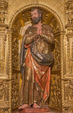 AVILA, SPAIN, APRIL - 19, 2016: The carved polychrome baroque statue of St. Peter on side altar in church Basilica de San Vicente