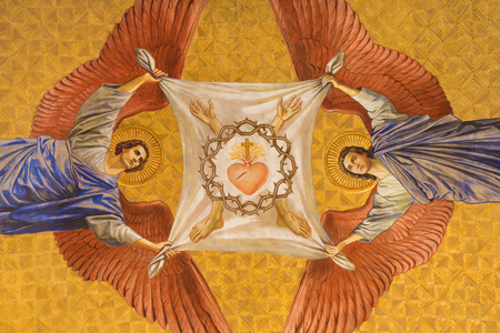 BERLIN, GERMANY, FEBRUARY - 14, 2017: The fresco of anges with the crown of thorns and heart of Jesus in Herz Jesus church by Friedrich Stummel and Karl Wenzel from end of 19. and begin of 20. cent.