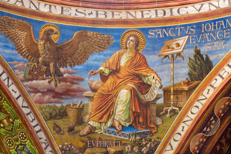 BERLIN, GERMANY, FEBRUARY - 15, 2017: The fresco of St. john the Evangelist in cupola of Rosenkranz Basilica by Friedrich Stummels, Karl Wenzel, and Theodor Nuttgens from begin of 20. cent. Editöryel