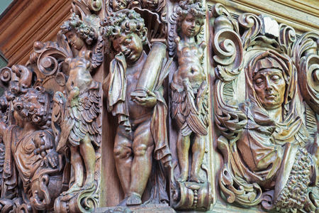 BRUGGE, BELGIUM - JUNE 12, 2014: The carved statues of angels on the pilpit in st. Jocobs church (Jakobskerk) by B. de Lannoy (1685-1689).