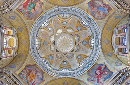 TURIN, ITALY - MARCH 13, 2017: The cupola with the frescoes of the Evangelist in church Chiesa di San Lorenzo by Carlo Felice (1827).