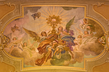 TURIN, ITALY - MARCH 13, 2017: The fresco of Eucharistic adoration of angels in ceiling of church Chiesa di Santo Tomaso by N. Arduino (1938).