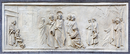 TURIN, ITALY - MARCH 15, 2017: The relief of jesus and rich young ruler on the facade of church Basilica Maria Ausiliatrice by Emilio Spalla (1897 - 1971). Редакционное
