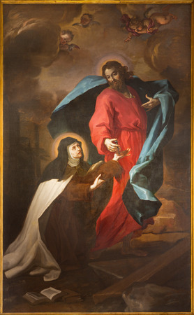 TURIN, ITALY - MARCH 13, 2017: The painting of Stigmatization of St. Theresia of Avila in church Chiesa di Santa Teresa by Bartolomeo Garavoglia from 16. cent.