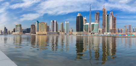 DUBAI, UAE - MARCH 29, 2017: The skyline with the bridge over the new Canal and Downtown and Burj Khalifa tower. Editorial