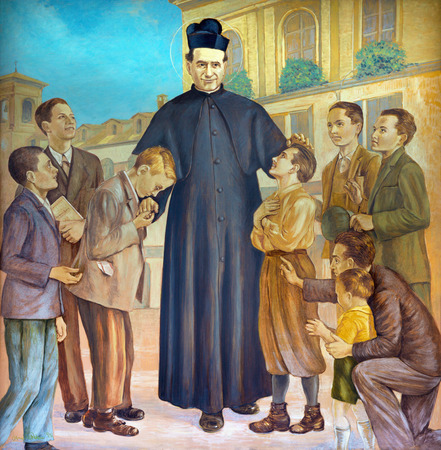 TURIN, ITALY - MARCH 15, 2017: The painting of Saint Don Bosco in the middle of his boys in church Basilica Maria Ausiliatrice by Paolo Giovanni Crida (20 cent.).