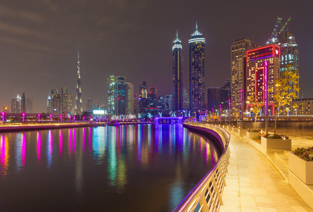 Dubai - The nightly skyline over the Canal and Downtown with the waterfall on the bridge.