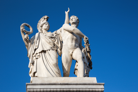 BERLIN, GERMANY, FEBRUARY - 13, 2017: The sculpture on the Schlossbruecke - Athena leads the young warrior into the fight (Pallas Athene führt den jungen Krieger in den Kampf) by Albert Wolff, 1853.