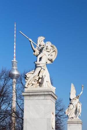 BERLIN, GERMANY, FEBRUARY - 13, 2017: The sculpture on the Schlossbruecke - Athena protects the young hero (Der unter dem Schutze Pallas Athenes zum Kampf ausfallende Krieger) by Gustav Blaeser 1854.