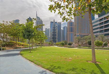 mirror: Dubai - The park and The Jumeirah lake towers.