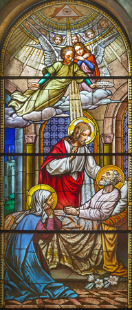 TURIN, ITALY - MARCH 15, 2017: The death of St. Joseph on the stained glass of church Basilica Maria Ausiliatrice by unknown artist from end of 19. cent. Editorial
