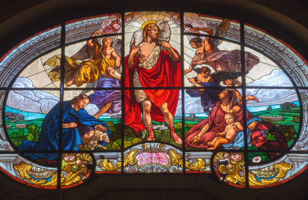 TURIN, ITALY - MARCH 13, 2017: The stained glass of Good Shepherd in Church Chiesa di Santo Tommaso by from year 1903.